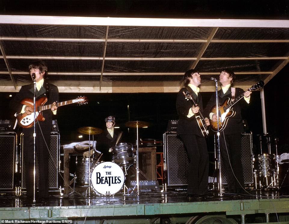 16155650-7256365-The_beatles_perform_at_the_Busch_Stadium_in_St_Louis_Missouri_on-m-2_15633799...jpg