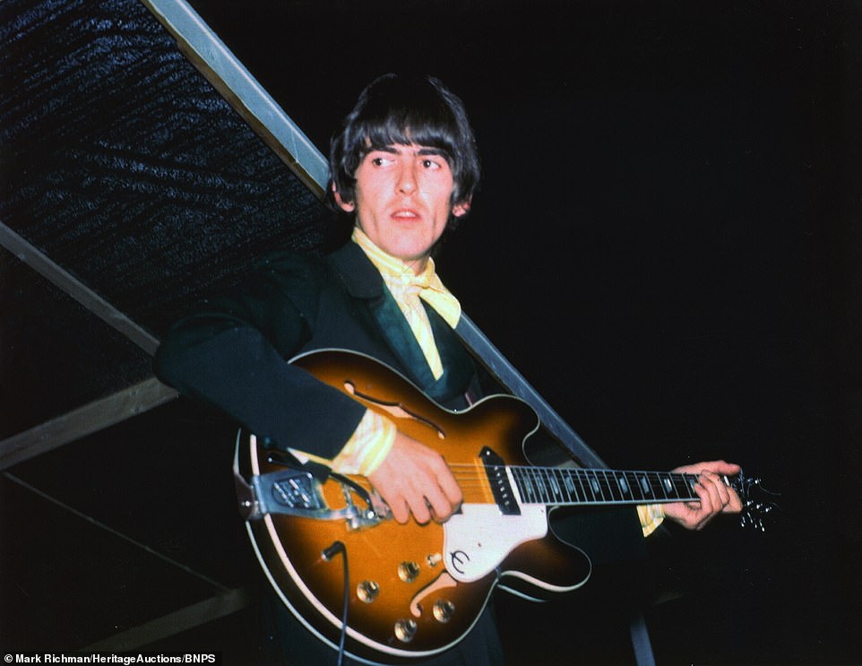16155652-7256365-Beatle_George_Harrison_looks_tense_as_he_plays_his_guitar_in_thi-a-10_1563380...jpg
