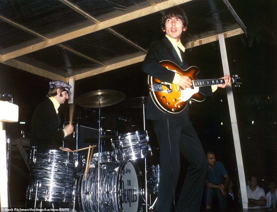 16155658-7256365-George_Harrison_plays_guitar_in_front_of_drummer_Ringo_Starr_at_-m-8_15633800...jpg